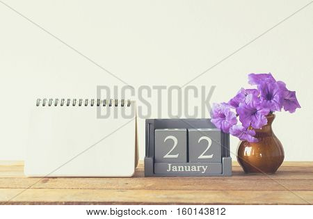 Vintage Wood Calendar For January Day 22 On Wood Table With Empty Note Book Space For Text.