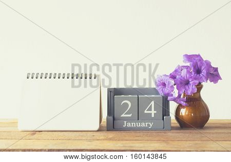 Vintage Wood Calendar For January Day 24 On Wood Table With Empty Note Book Space For Text.