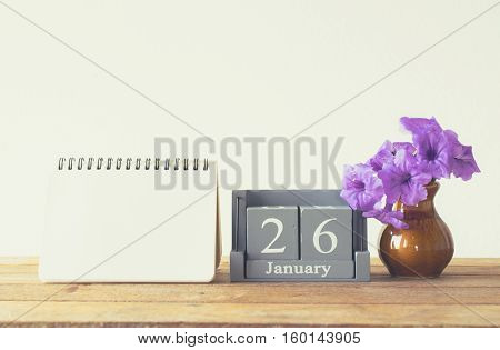 Vintage Wood Calendar For January Day 26 On Wood Table With Empty Note Book Space For Text.