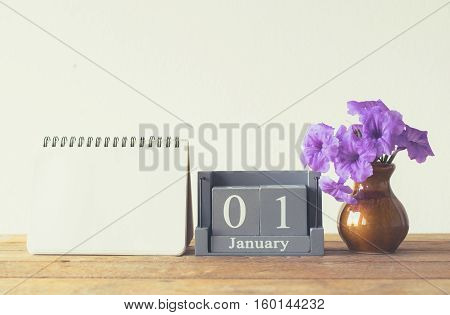 Vintage Wood Calendar For January Day 1 On Wood Table With Empty Note Book Space For Text.