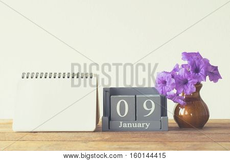 Vintage Wood Calendar For January Day 9 On Wood Table With Empty Note Book Space For Text.