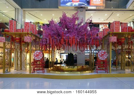 BEIJING - FEBRUARY 24: The Chinese new Year of Monkey set up in front of the luxury shopping mall at downtown in Beijing. Just before the Spring Festival and Chinese new year, February 24, 2016.