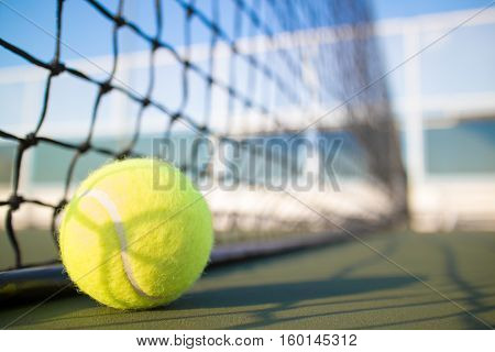 Tennis ball on a tennis hard court
