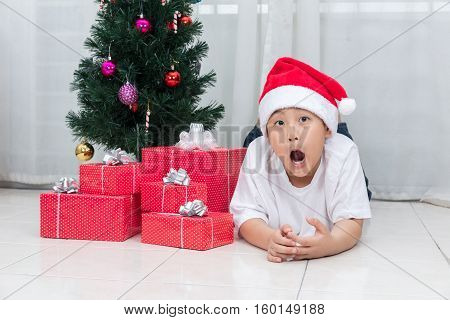 Asian Chinese Little Boy Showing Funny Expression With Christmas Presents