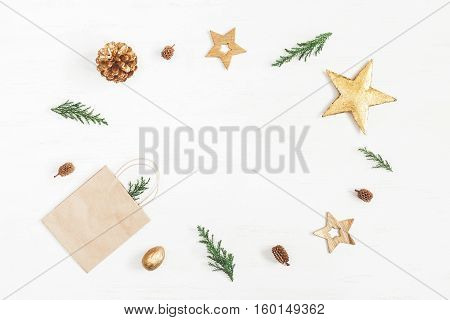 Christmas composition. Gift christmas decoration cypress branches pine cones. Flat lay top view