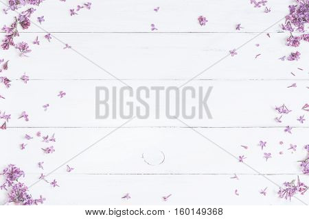 Spring flowers . Lilac flowers on white wooden background. Top view flat lay