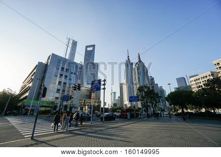 people cross the road go to Oriental Pearl Tower taken in Shanghai on 15 November 2016