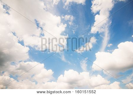 The Blue summer sky with cumulus clouds