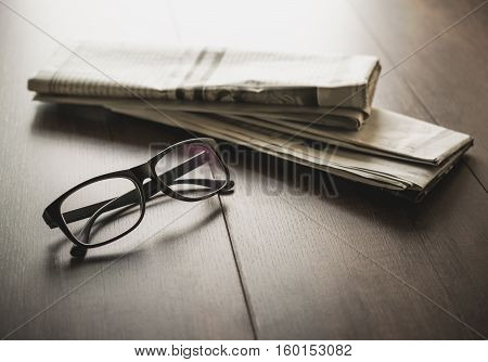 Newspaper And Reading Glasses On Business Desk Business Newspaper Background Concept.