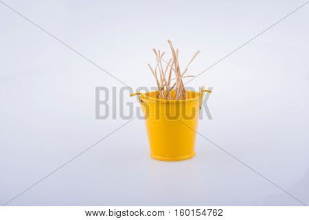 Straw In Bucket On A White Background