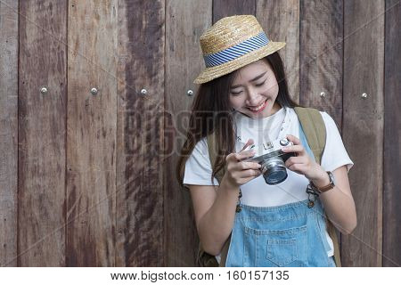 Young Asian Butiful Woman With Camera. In A Blue Shirt. Hipster Fashion Photographer Girl. Young Peo
