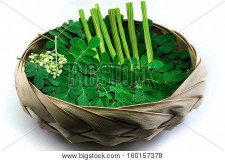 Moringa leaf and drumstick in a natural bowl