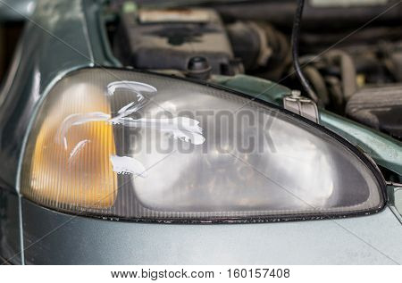 Closeup car lamp or front headlight polishing renewed headlamp