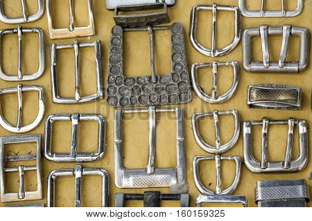 Vintage Belt Buckles Placed On  Yellow Cloth
