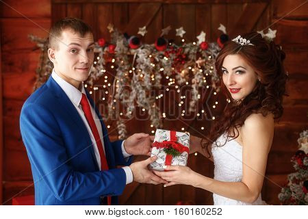 Christmas wedding. Young happy bride and groom together. Marriage concept