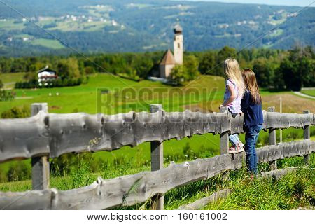 Two Adorables Little Sisters Admiring Beautiful Landscape In Dolomites Mountain Range, South Tyrol,