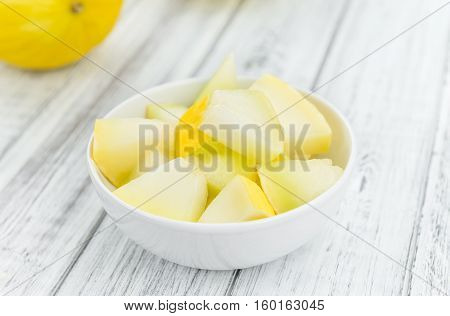 Portion Of Yellow Honeydew Melon On Wooden Background (selective Focus)