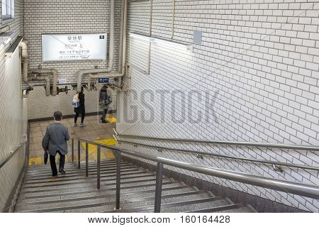 Tokyo, Japan - NOV 18, 2016 : Passengers walking down stairs for train the gate in the Tsukiji Station
