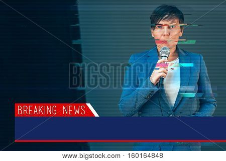 Breaking news with digital glitch effect - elegant female television journalist doing business reportage holding microphone in hands
