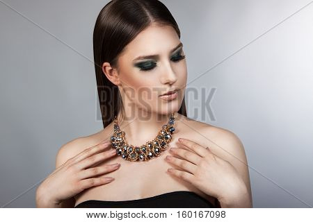 Portrait Of A Young Beautiful Girl With A Professional Make-up. Luxury Perfect Hair. Bright Makeup.