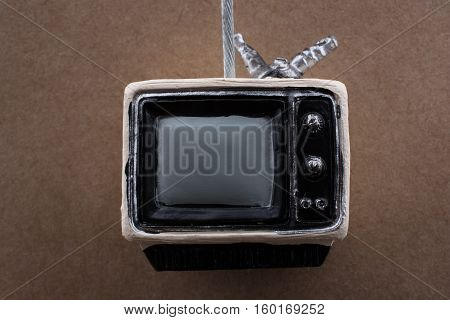 Retro Syled Tiny Television Model On Brown Background