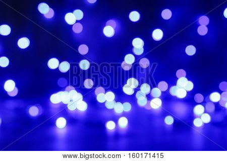 Blured purple, white and blue christmas light background