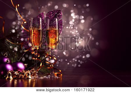 champagne glass with a festive christmas decoration as background