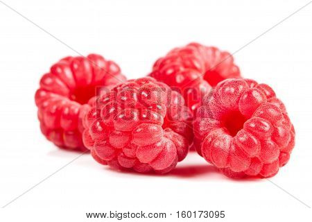Ripe Raspberries On White Background. Red Juicy Berries Closeup.
