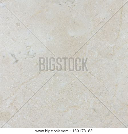Natural beige polished Spanish Crema Marfil marble texture.