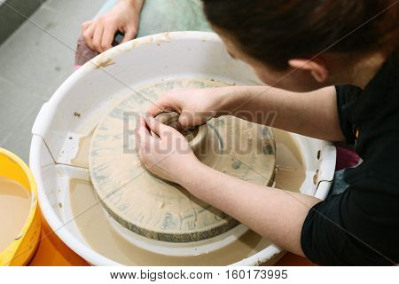 pottery. the teacher teaches the student work on the potter's wheel
