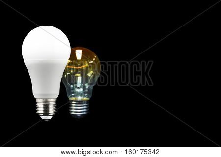 Led light bulb on dark background with Blurred incandescent light bulb and copy space on the right screen