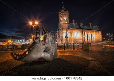 Cardiff, Wales, GB - December 4, 2016: A sculptural memorial for the many merchant seamen that died caught up in armed conflict in front of the The Pierhead Building, a Grade I listed building in Cardiff.