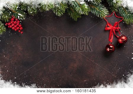 Christmas stone background with snow fir tree and decor. Top view with copy space