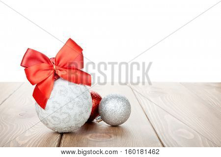 Christmas baubles decor on wooden table