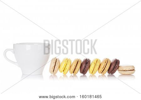 Colorful macaroons and cup of drink. Sweet macarons. Isolated on white background