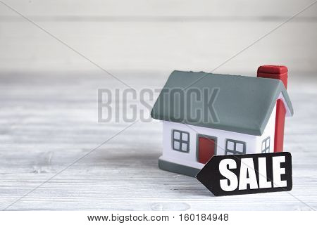 concept of selling home on wooden background close up