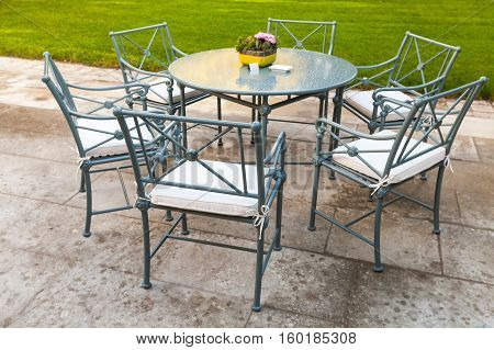 Metal Chairs Stand Around Round Table