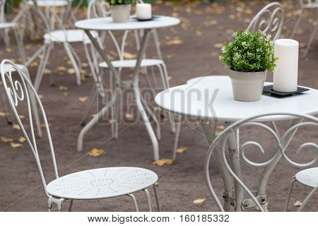 Metal White Chairs And Tables In Park