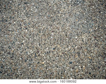 Background of gray stones texture close up. A mosaic of tiny gravel stones. Tiny gravel stones pattern.