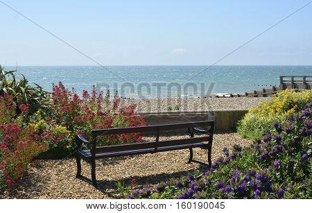 Bench in garden overlooking the sea at Bognor Regis in West Sussex England