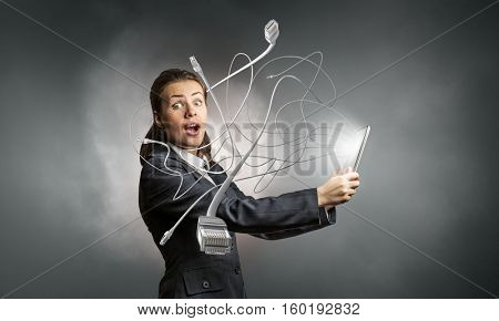 Businesswoman with tablet pc . Mixed media