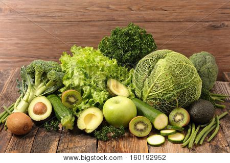 composition with green fruit and vegetable