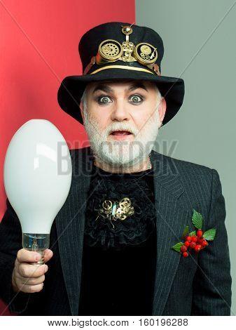 Amazed Man Holds Light Bulb