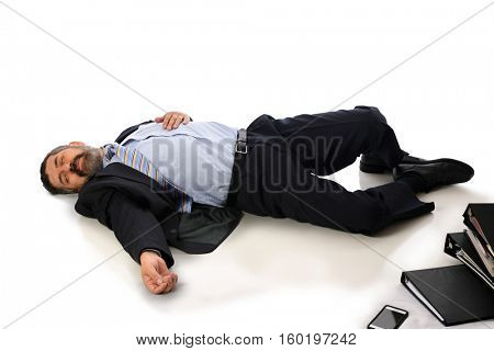 Businessman laying injured on the floor isolated over white background