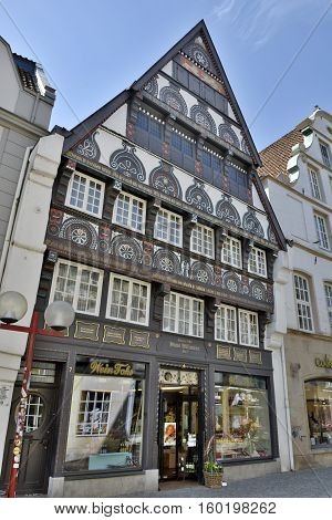 Osnabruck, Germany - April 22, 2016. Renaissance Haus Willmann 1586 building on Krahnstrassehe 7 in Osnabruck, with commercial properties.