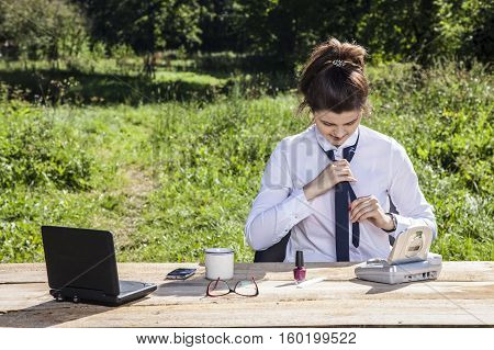 Business Woman Struggling With A Tie