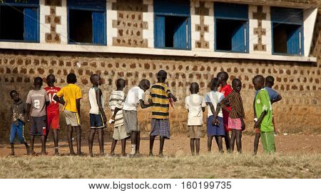 TORIT, SOUTH SUDAN-FEBRUARY 20, 2013: Unidentified students line up outside a school in South Sudan