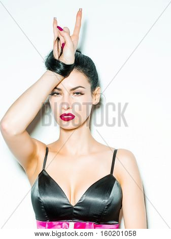 Pretty Girl Shows Horns Gesture