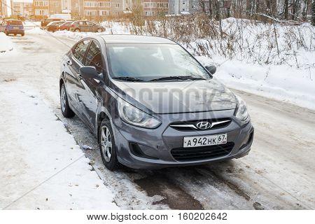 Smolensk, Russia - November 13, 2016: New Hyundai Solaris (Accent) parked in winter street.
