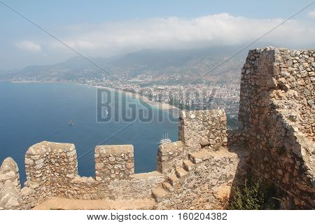 Walls fortress of Alanya Kale. Alanya Castle (Alanya Kalesi) is a medieval castle in the southern Turkish city of Alanya.